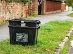 black recycling boxes